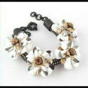 J CREW BLACK WHITE AND SILVER FLOWER CORD BRACELET
